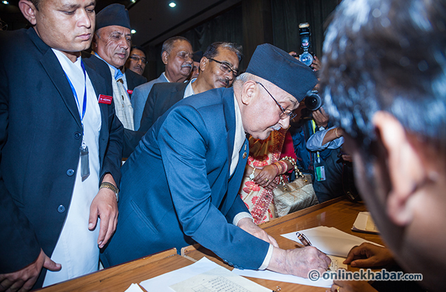 Kp-oli-sign-on-the-Constitution-of-Nepal