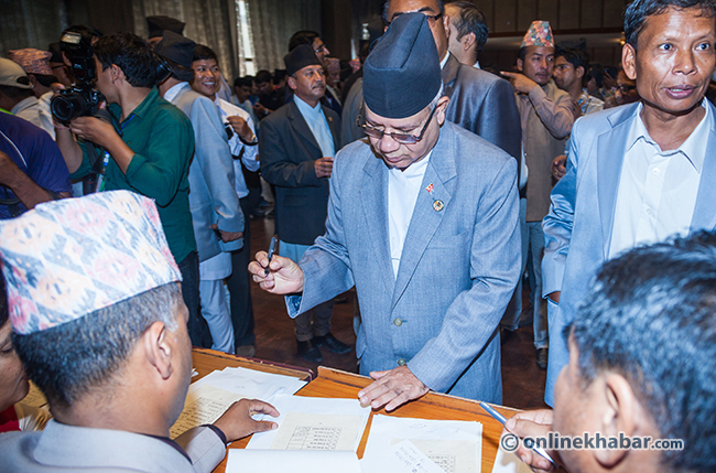 Madhav-Nepal-sign-on-the-Constitution-of-Nepal