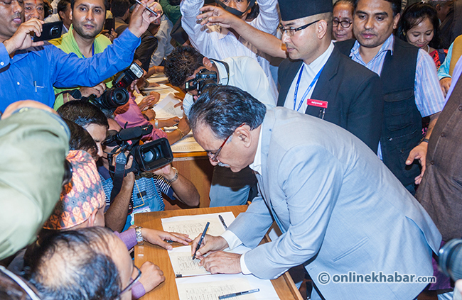 Prachanda-sign-on-the-Constitution-of-Nepal